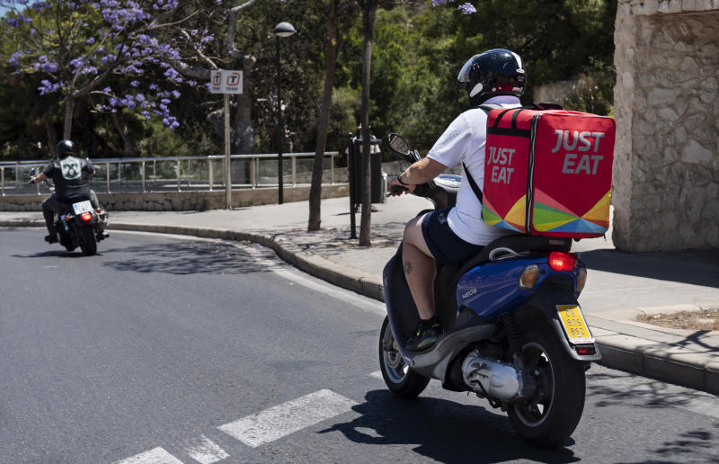 SPAIN - 2019/06/20: Online food order and delivery service company, Just Eat motorbike courier seen in Spain. (Photo by Miguel Candela/SOPA Images/LightRocket via Getty Images)