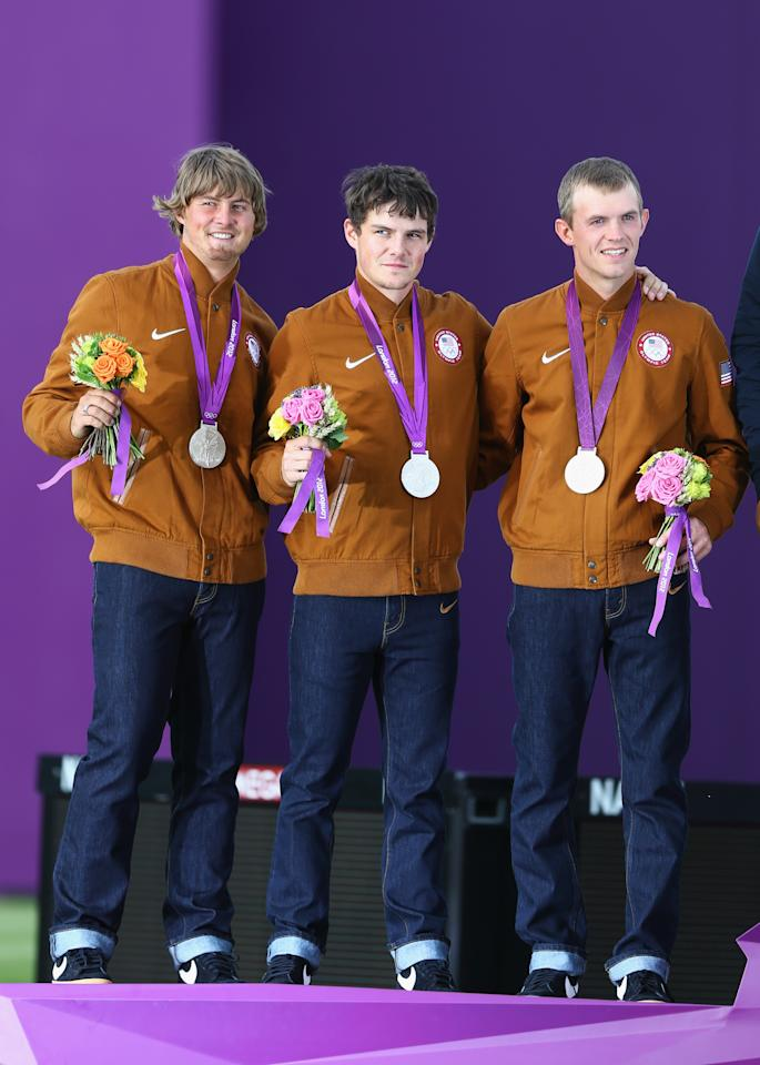 LONDON, ENGLAND - JULY 28:  (L-R) Silver medalists Brady Ellison, Jake Kaminski and Jacob Wukie of the United States stand on the podium during the medal ceremony after the Men's Team Archery Final between the United States and Italy on Day 1 of the London 2012 Olympic Games at Lord's Cricket Ground on July 28, 2012 in London, England.  Italy won gold and Korea won bronze.  (Photo by Paul Gilham/Getty Images)