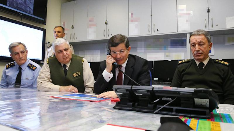 Handout picture by Turkish Prime Minister's Press Office on February 22, 2015, shows Prime Minister Ahmet Davutoglu (C) following the operation of the relocation of Saygi Outpost and Tomb of Suleyman Shah, in Ankara (AFP Photo/Hakan Goktepe)