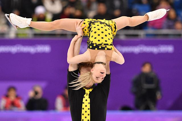 <p>Gold:$61,000 USD<br>Silver:$38,000 USD<br>Bronze: $26,000 USD <br>Evgenia Tarasova and Vladimir Morozov compete in the pairs free skate event during the Pyeongchang 2018 Winter Olympic Games.<br>(Mladen ANTONOV / AFP) </p>