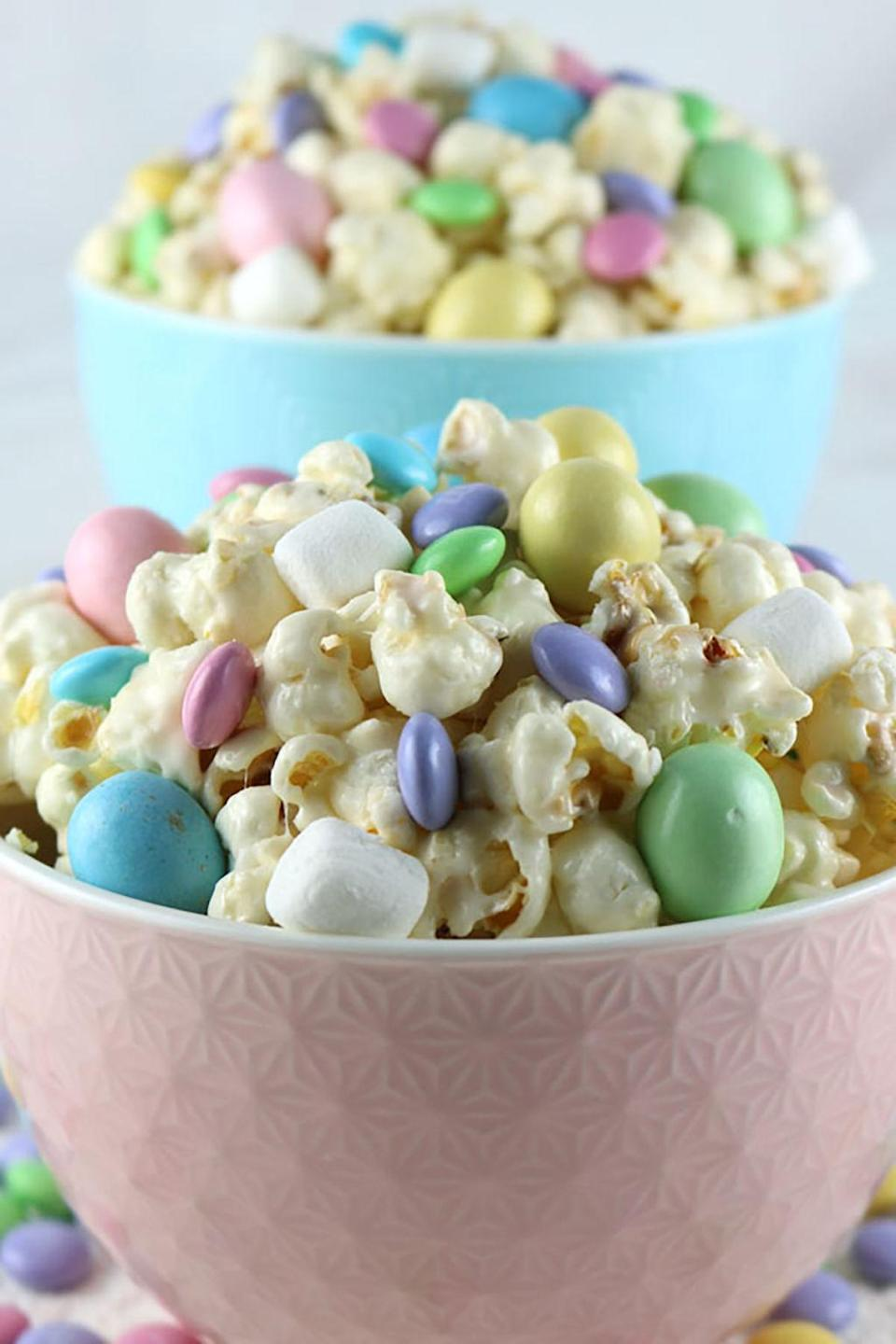 """<p><span>Melted marshmallow coats the popcorn in this crunchy Easter treat, which tastes as sweet as it looks!</span></p><p><strong>Courtesy of <a href=""""http://www.twosisterscrafting.com/easter-candy-popcorn/"""" rel=""""nofollow noopener"""" target=""""_blank"""" data-ylk=""""slk:Two Sisters Crafting"""" class=""""link rapid-noclick-resp"""">Two Sisters Crafting</a>. </strong></p>"""