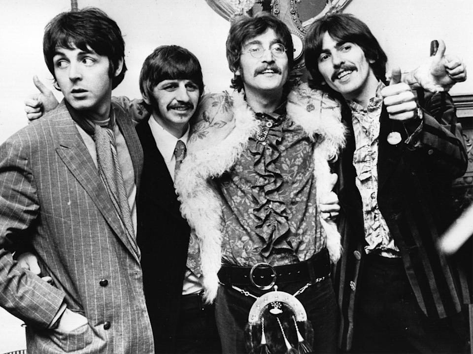 John Lennon (second to right) with The Beatles on 19 May 1967, just after recording 'Sgt Pepper'Getty Images