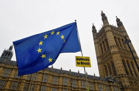 A European Union flag with an anti-Brexit banner is flown outside of the Houses of Parliament in London, Britain, January 10, 2019. REUTERS/Toby Melville