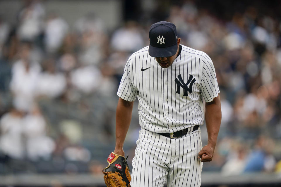 New York Yankees relief pitcher Wandy Peralta reacts during the fourth inning of a baseball game against the Tampa Bay Rays, Sunday, Oct. 3, 2021, in New York. (AP Photo/Frank Franklin II)