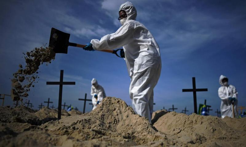 Activists dig 100 mock graves on Copacabana beach in Rio de Janeiro, Brazil on 11 June 2020.