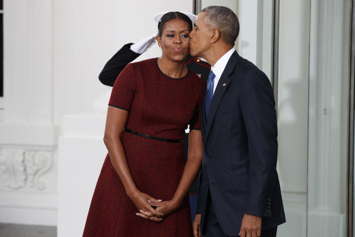 <p>President Barack Obama kisses first lady Michelle Obama as they wait for President-elect Donald Trump and his wife Melania Trump at the White House, Friday, Jan. 20, 2017, in Washington. (Photo: Evan Vucci/AP) </p>
