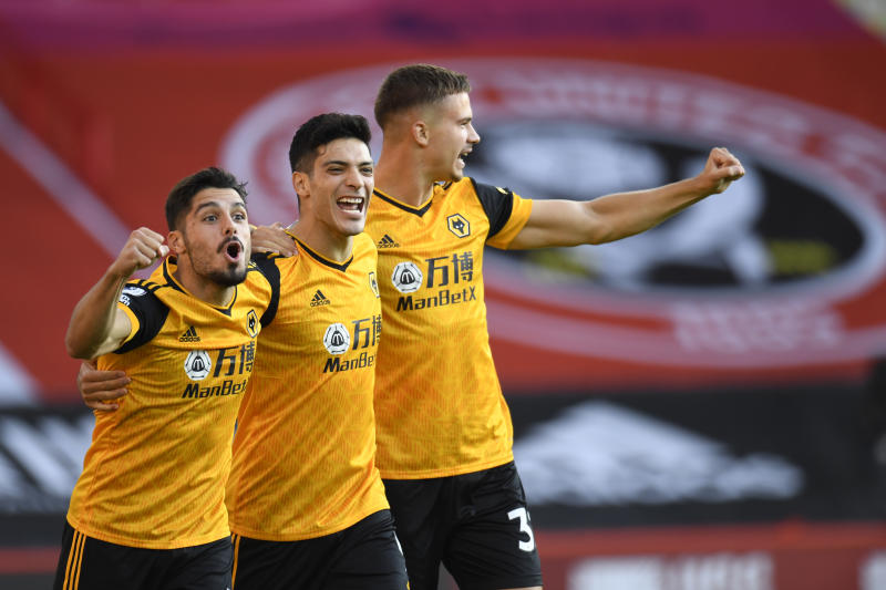 Wolverhampton Wanderers' Raul Jimenez, centre, celebrates scoring his sides first goal during the English League Cup soccer match between Sheffield United and Wolves at Bramall Lane stadium in Sheffield, England, Monday, Sept. 14, 2020. (Peter Powell/Pool via AP)