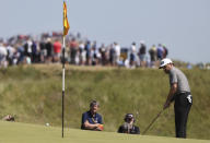 South Africa's Louis Oosthuizen puts on the 4th green during the final round of the British Open Golf Championship at Royal St George's golf course Sandwich, England, Sunday, July 18, 2021. (AP Photo/Ian Walton)
