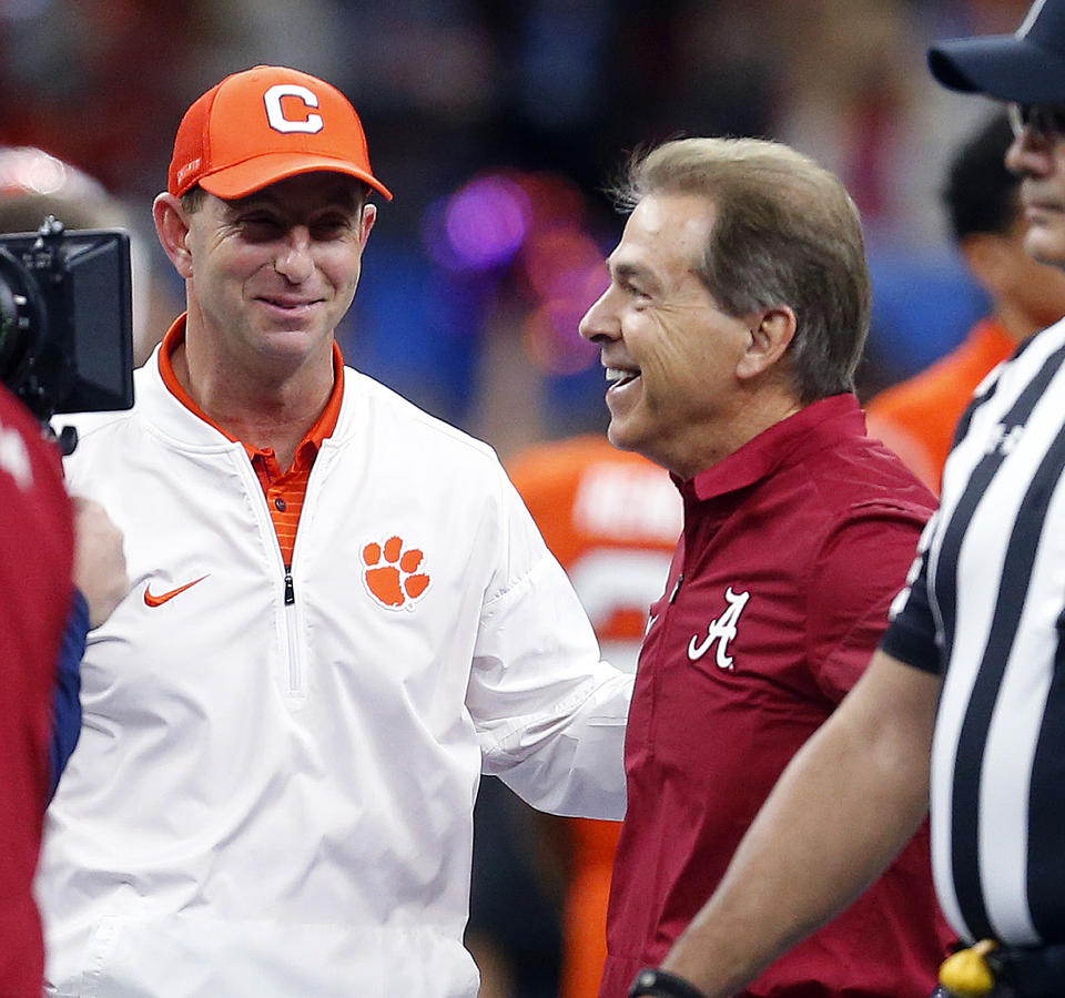 Clemson head coach Dabo Swinney and Alabama head coach Nick Saban, right, talk before the Sugar Bowl semifinal playoff game in New Orleans on Jan. 1, 2018. (AP Photo/Butch Dill)