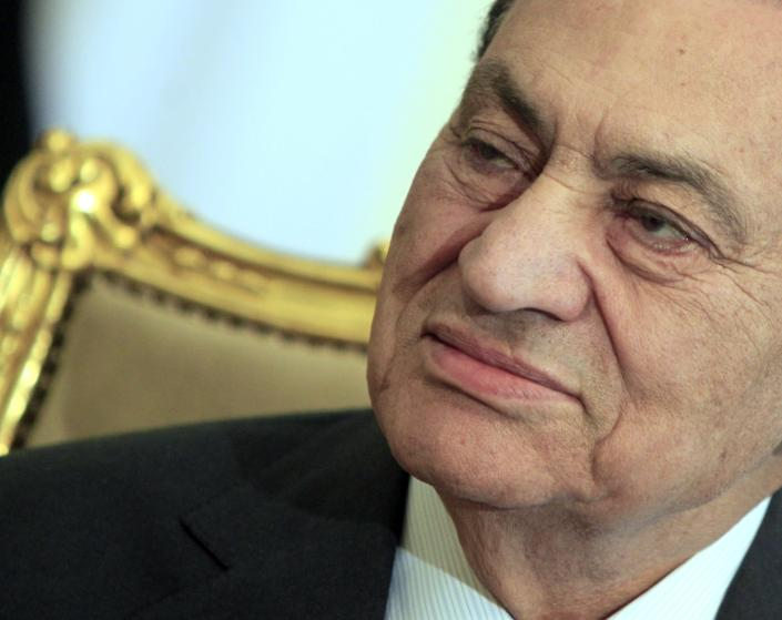 FILE - In this Tuesday, Feb. 8, 2011 file photo, then Egyptian President Hosni Mubarak sits during his meeting with Emirates foreign minister, at the Presidential palace in Cairo, Egypt. A public prosecutor in Egypt has referred ousted longtime autocrat Hosni Mubarak to a new trial on charges of embezzling state funds to build and renovate family homes. Egypt's state news agency said Mubarak and his sons have misappropriated $18 million between 2002 and 2011 to renovate and build homes and offices in seven different areas in Egypt, using state funds. (AP Photo/Amr Nabil, File)