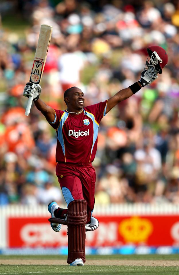 HAMILTON, NEW ZEALAND - JANUARY 08:  Dwayne Bravo of the West Indies celebrates his century during game five of the One Day International Series between New Zealand and the West Indies at Seddon Park on January 8, 2014 in Hamilton, New Zealand.  (Photo by Phil Walter/Getty Images)