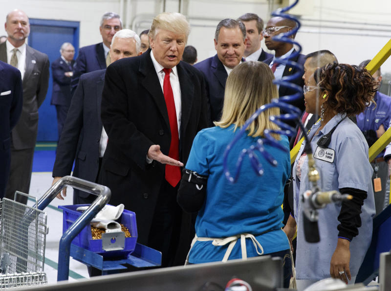 FILE - In this Dec. 1, 2016, file photo, President-elect Donald Trump greets workers during a visit to the Carrier Corp. factory in Indianapolis. The $7 million deal to save jobs at the Carrier factory in Indianapolis is poised for approval by state officials nearly four months after President Donald Trump celebrated his role in the negotiations with a post-election visit to the plant. (AP Photo/Evan Vucci, File)