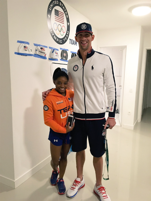 """<p>Biles took time to give props to the Team USA swimmers: """"Congrats to @Nathangadrian & @MichaelPhelps on the 4×100 meter GOLD!"""" (@Simone_Biles/Twitter) </p>"""