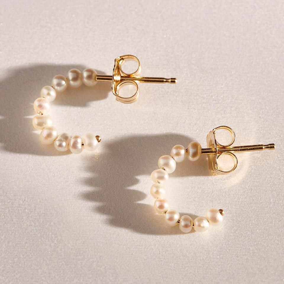 """<h3>Catbird Baby Pearl Hoop Earring</h3><br>Catbird is a Brooklyn staple. The beloved Bedford Avenue store is home to an assortment of engagement rings, fine jewelry, sweet home decor, and kitschy finds. The shop is single-handedly responsible for introducing us to some of our favorite jewelry brands like Wwake, Jennie Kwon, Satomi Kawakita, and so many more.<br><br><strong>Catbird</strong> Baby Pearl Hoop, $, available at <a href=""""https://go.skimresources.com/?id=30283X879131&url=https%3A%2F%2Fwww.catbirdnyc.com%2Fbaby-pearl-hoop-single.html"""" rel=""""nofollow noopener"""" target=""""_blank"""" data-ylk=""""slk:Catbird"""" class=""""link rapid-noclick-resp"""">Catbird</a>"""