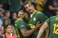 South Africa's Lukhanyo Am, left, is congratulated by teammate Eben Etzebeth after scoring a try during the Rugby Championship test match between the Springboks and the Wallabies in Brisbane, Australia, Saturday, Sept. 18, 2021. (AP Photo/Tertius Pickard)