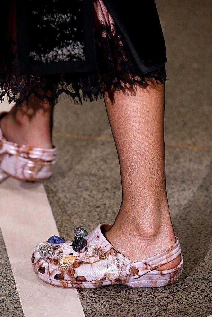 A model walks the runway at the Christopher Kane show wearing Crocs during London Fashion Week on September 19, 2016 in London, United Kingdom. (Photo: Victor VIRGILE/Gamma-Rapho via Getty Images)