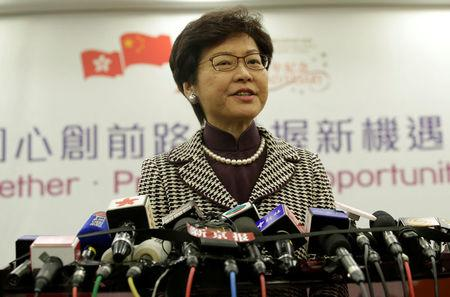 Hong Kong leader-elect Carrie Lam attends a news conference in Beijing