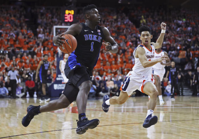 Virginia's forward Francesco Badocchi (1) pushes the ball down court on a breakaway during the first half of an NCAA college basketball game against Virginia on Saturday, Feb. 9, 2018, in Charlottesville, Va. (AP Photo/Zack Wajsgras)