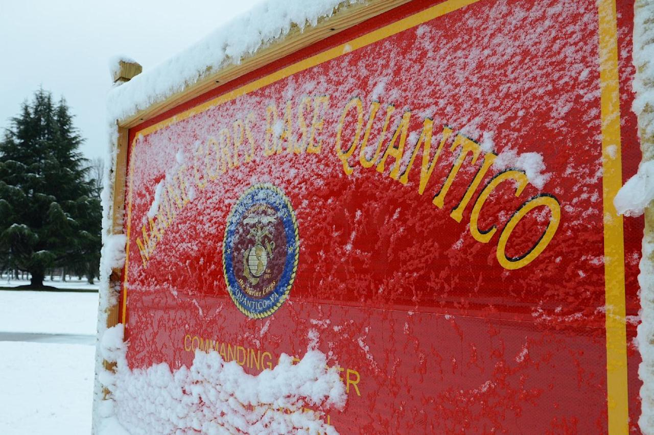 ADDS FIRST NAME AND RANK OF BASE SPOKESMAN - This image provided by the U.S. Marine Corps shows snow covering one of Marine Corps Base Quantico's many signs Wednesday March 6, 2013. Three people, including the suspect, were killed in a shooting at Marine Base Quantico, a base spokesman said early Friday March 22, 2013. Lt. Agustin Solivan said they believe the suspect, whose name wasn't released, is a staff member at the officer candidate school at the base. No information on the victim was immediately released. (AP Photo/US Marine Corps, Cpl. Antwaun L. Jefferson)