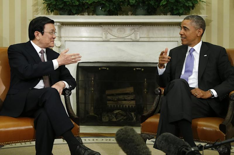 President Barack Obama meets with Vietnam's President Truong Tan Sang in the Oval Office at the White House in Washington, Thursday, July 25, 2013. President Barack Obama says he and Vietnamese President Truong Tan Sang are committed to completing a regional trade pact before the end of the year. He said it would create jobs and increase investments in the Asia-Pacific region and in both countries. (AP Photo/Charles Dharapak)