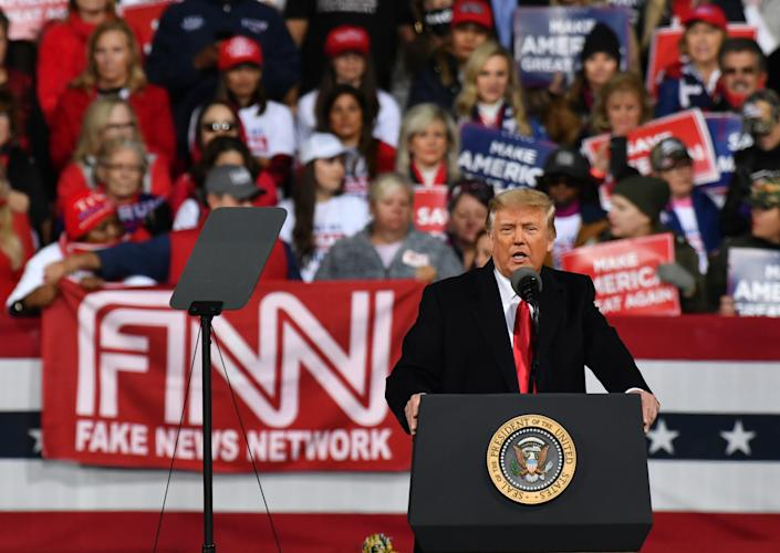 """President Donald J. Trump addresses the crowd at a """"Victory Rally"""" with GOP Sens. David Perdue and Kelly Loeffler in Valdosta, GA. (Photo by Peter Zay/Anadolu Agency via Getty Images)"""