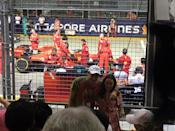 Fans posing with the Ferrari team in the background. (PHOTO: Yahoo Lifestyle Singapore)