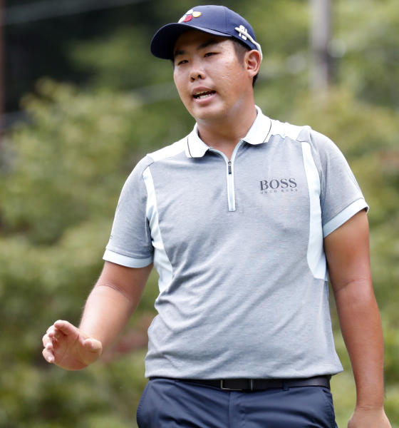 Byeong Hun An waves to the crowd after he made a birdie on the third hole during the final round of the Wyndham Championship golf tournament at Sedgefield Country Club in Greensboro, N.C., Sunday, Aug. 4, 2019. (AP Photo/Chris Seward)