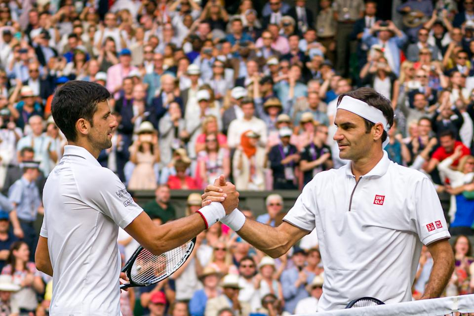 Roger Federer(圖右)、Novak Djokovic。(Photo by Andy Cheung/Getty Images)