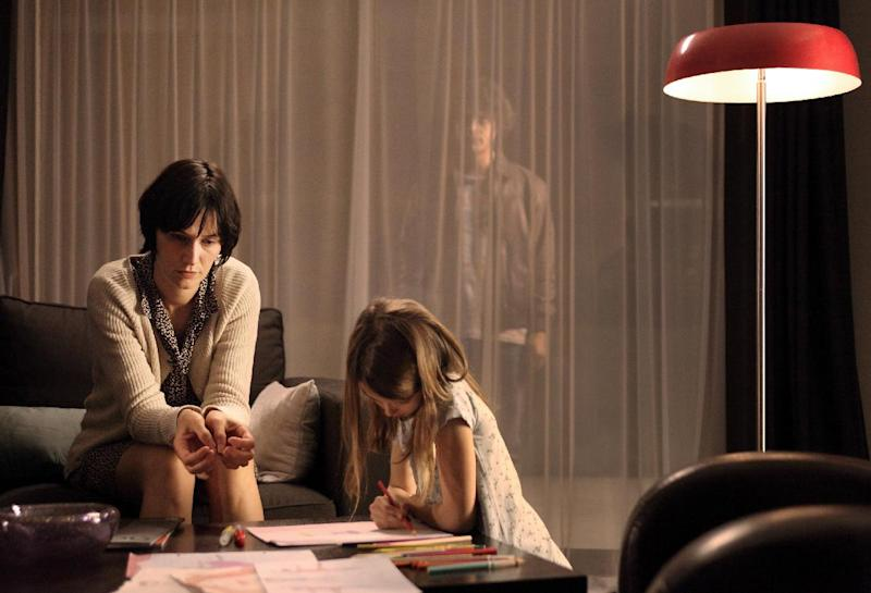 "This image released by The Sundance Channel shows Clotilde Hesme, left, Brune Martin, center, and Pierre Perrier in a scene from ""The Returned,"" premiering Oct. 31, at 9 p.m. EST. (AP Photo/The Sundance Channel, Jean Claude Lother)"