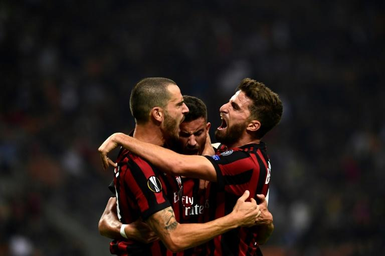 AC Milan's Mateo Musacchio (C) celebrates with teammates Leonardo Bonucci (L) and Fabio Borini after scoring a goal during their UEFA Europa League group stage match against HNK Rijeka, at the San Siro stadium in Milan, on September 28, 2017