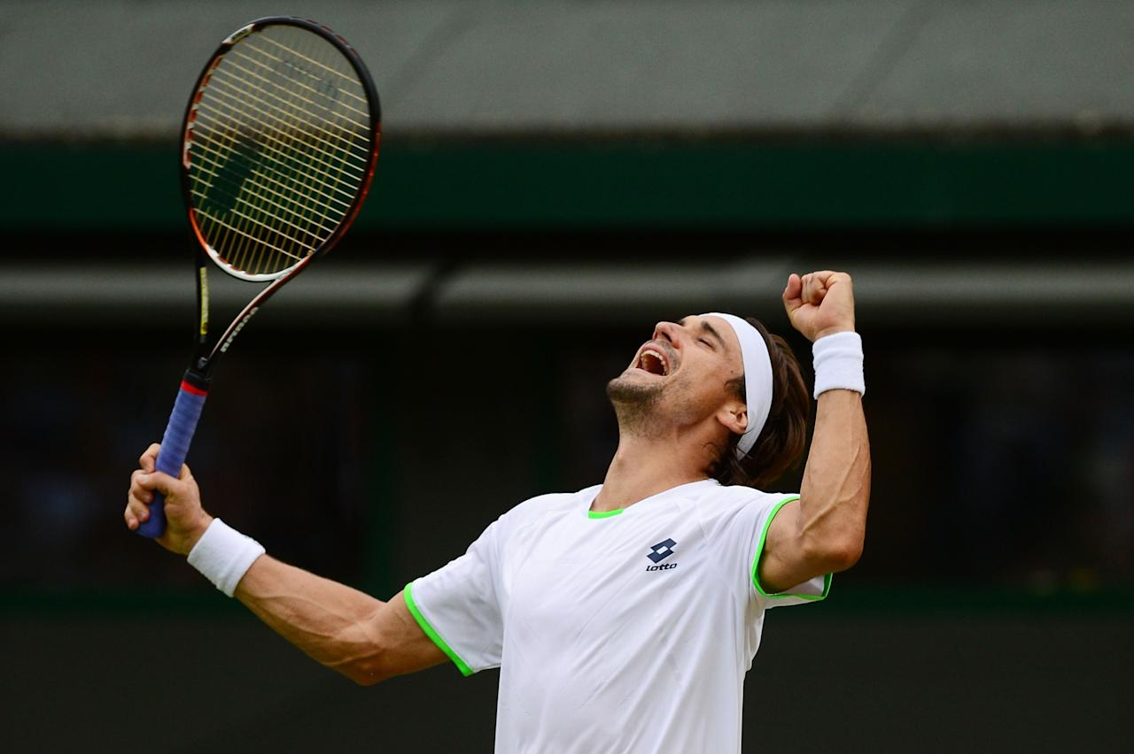 LONDON, ENGLAND - JUNE 29: David Ferrer of Spain celebrates match point during the Gentlemen's Singles third round match against Alexandr Dolgopolov of Ukraine on day six of the Wimbledon Lawn Tennis Championships at the All England Lawn Tennis and Croquet Club on June 29, 2013 in London, England. (Photo by Mike Hewitt/Getty Images)