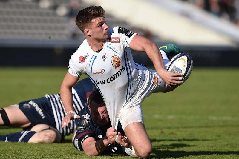 Exeter's fly-half Henry Slade (C) passes the ball during a European Champions Cup rugby union match in Bordeaux, France, in December 2016