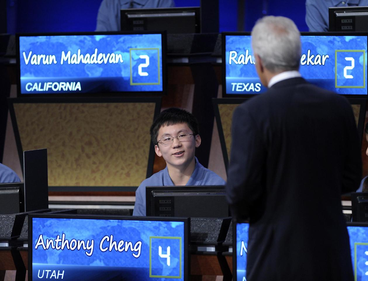 Anthony Cheng, 13, from Midvale Middle School in Midvale, Utah, talks with Alex Trebek during the National Geographic Bee in Washington, Thursday, May 24, 2012. (AP Photo/Susan Walsh)