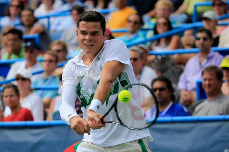 Milos Raonic of Canada returns a shot to Vasek Pospisil of Canada during the mens finals of the Citi Open at the William H.G. FitzGerald Tennis Center on August 3, 2014 in Washington, DC