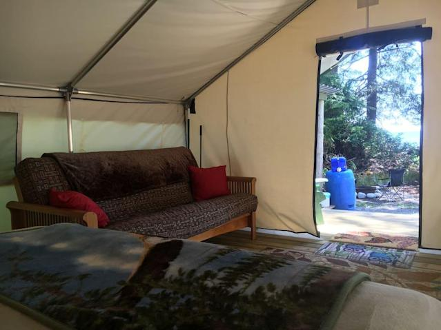 <p>Inside the tent, there's a futon, great for lounging or for additional guests. (Airbnb) </p>
