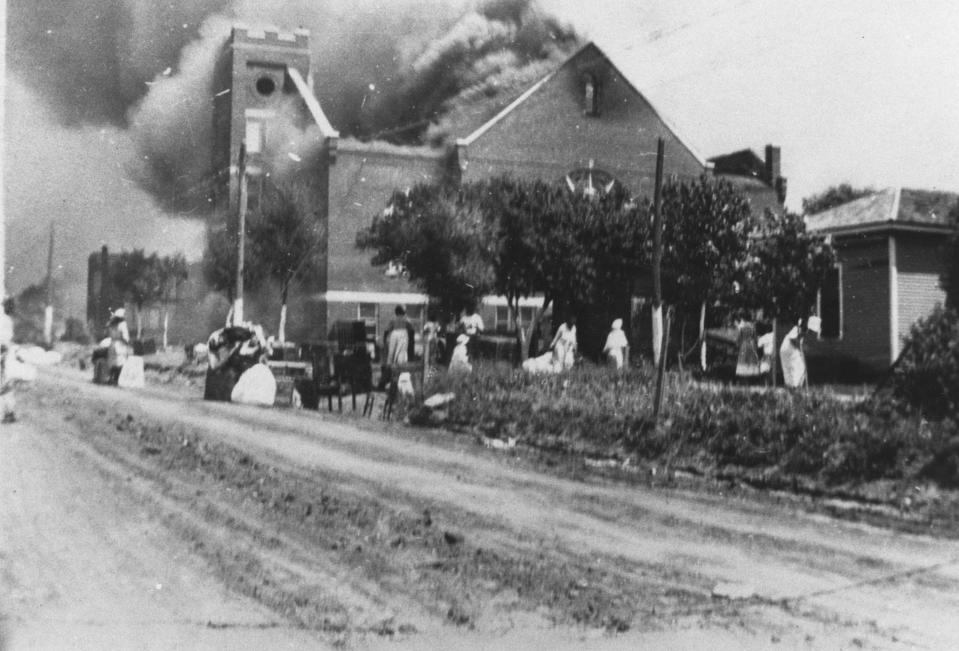 In this photo provided by the Department of Special Collections, McFarlin Library, The University of Tulsa, the Mt. Zion Baptist Church burns in Tulsa, Okla. during the Tulsa Race Massacre of June 1, 1921. (Department of Special Collections, McFarlin Library, The University of Tulsa via AP)