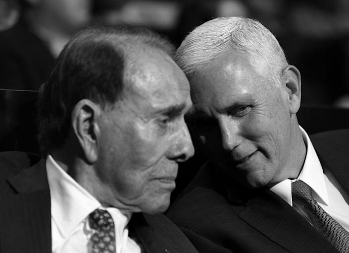 <p>Indiana Gov. Mike Pence speaks with former Senate Majority Leader Bob Dole at the Republican National Convention on Monday. (Photo: Khue Bui for Yahoo News)</p>