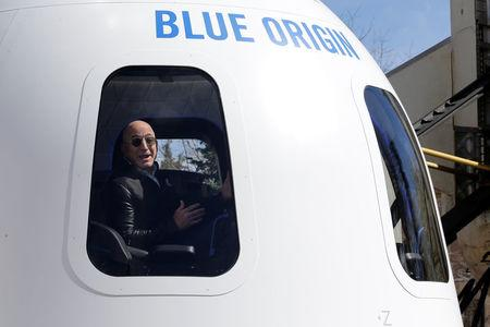 Amazon and Blue Origin founder Jeff Bezos addresses the media about the New Shepard rocket booster and Crew Capsule mockup at the 33rd Space Symposium in Colorado Springs