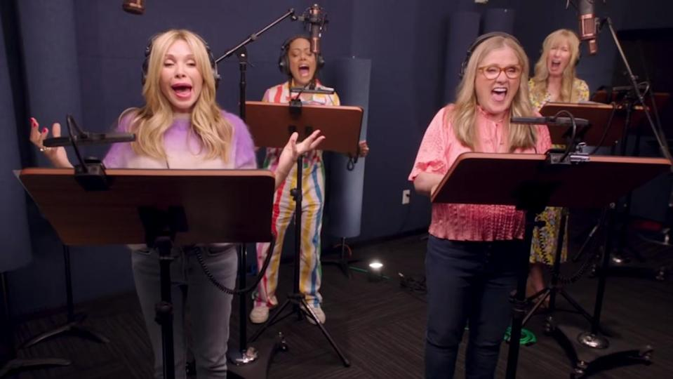 Rugrats voice actors stand together in a studio and scream into microphones