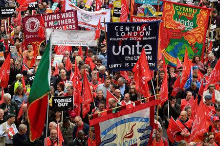Tens of thousands join march urging 'new deal' for workers
