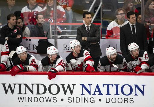 New Jersey Devils interim coach Alain Nasreddine watches during the first period of the team's NHL hockey game against the Washington Capitals, Saturday, Jan. 11, 2020, in Washington. (AP Photo/Al Drago)