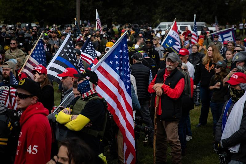 Several hundred members of the Proud Boys with U.S. flags and signs