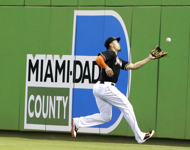 Miami Marlins right fielder Giancarlo Stanton catches a foul ball hit by Oakland Athletics' Josh Donaldson during the first inning of a baseball game, Saturday, June 28, 2014 in Miami. (AP Photo/Wilfredo Lee)