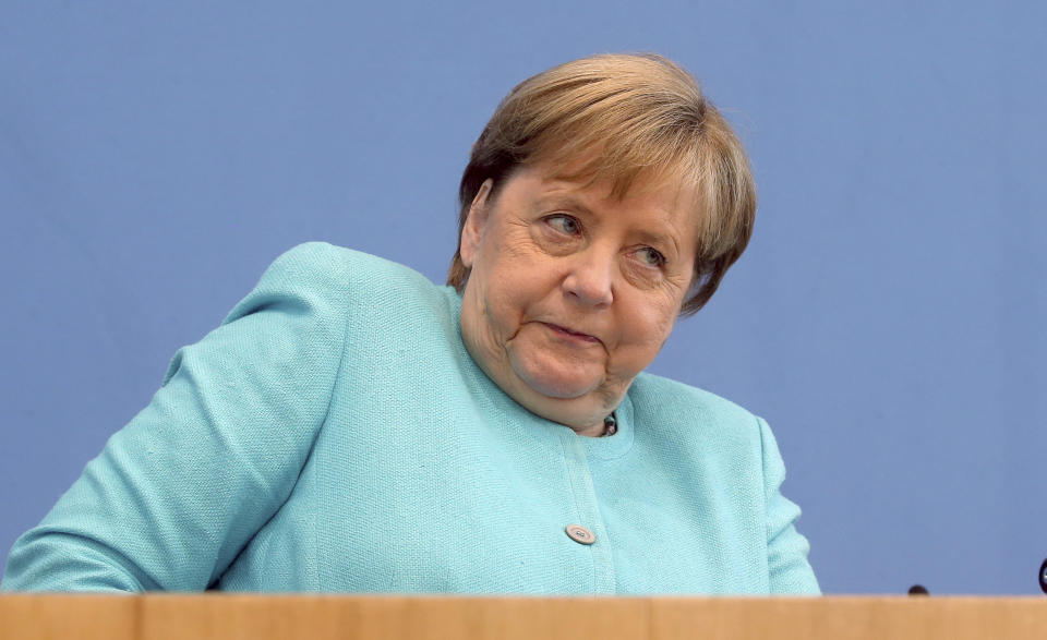 German Chancellor Angela Merkel, looks on, as she holds her annual summer news conference in Berlin, Germany, Thursday, July 22, 2021. (Wolfgang Kumm/dpa via AP)
