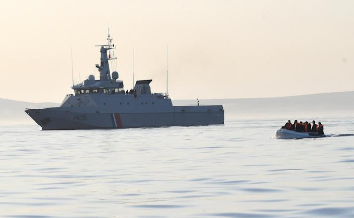 A French patrol boat escorts a dinghy carrying 13 migrants to Border Force on the English Channel last month. (Getty Images)