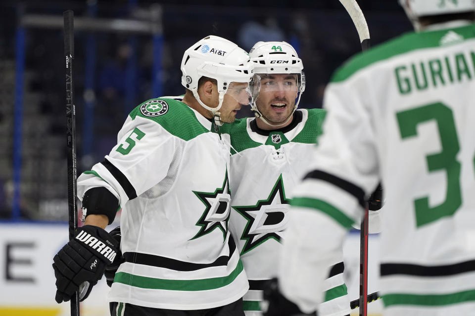 Dallas Stars defenseman Andrej Sekera (5) celebrates his goal against the Tampa Bay Lightning with defenseman Joel Hanley (44) during the third period of an NHL hockey game Wednesday, May 5, 2021, in Tampa, Fla. (AP Photo/Chris O'Meara)
