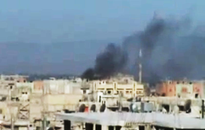This image made from amateur video and released by Shaam News Network Wednesday, March 21, 2012, purports to show black smoke rising from bulidings in Homs, Syria. The U.N. Security Council has strongly backed international envoy Kofi Annan's proposals to end the yearlong bloodshed in Syria. (AP Photo/Shaam News Network via APTN) THE ASSOCIATED PRESS CANNOT INDEPENDENTLY VERIFY THE CONTENT, DATE, LOCATION OR AUTHENTICITY OF THIS MATERIAL. TV OUT