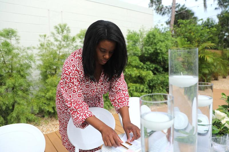 Woman arranging plate settings for a wedding.