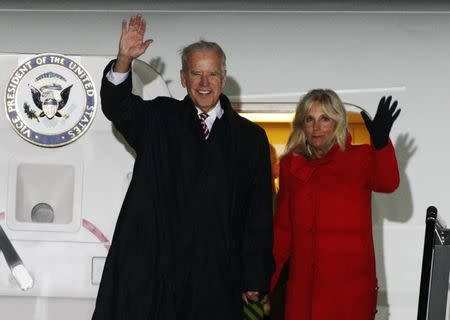 U.S. Vice President Joe Biden (L) and his wife Jill wave upon their arrival at Boryspil International airport outside Kiev November 20, 2014. REUTERS/Valentyn Ogirenko