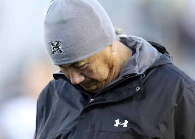 Hawaii coach Norm Chow walks off the field after a 59-56 loss during an NCAA college football game against Wyoming, Saturday, Nov. 23, 2013, in Laramie, Wyo. (AP Photo/The Wyoming Tribune Eagle, Michael Smith)